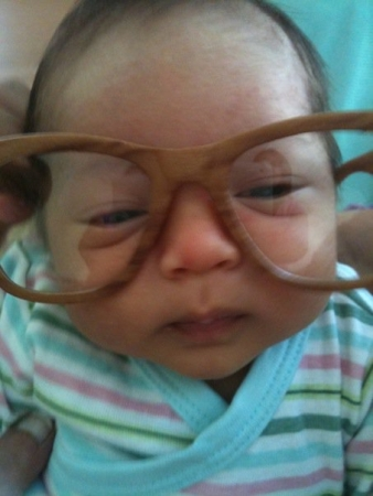 I like wearing one of Daddy's funky glasses. I'm half-Asian anyway, and Asian males wear glasses, no?